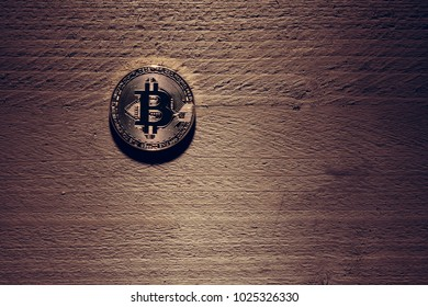 Bitcoin concept wood letters on wooden background