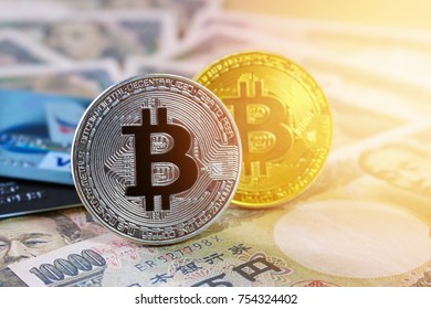 Bitcoin and credit card on Yen Japan banknote background