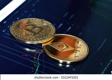 Bitcoin. Crypto currency Bitcoin, BTC, Bit Coin. Bitcoin and Ethereum golden coins on a chart. Blockchain technology, bitcoin mining concept
