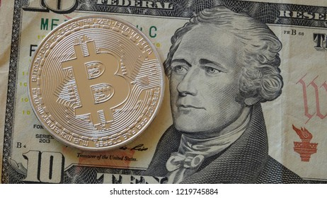 Bitcoin crypto currency coin with US dollar