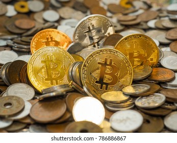 Bitcoin crypto currency coins  among large stack of coins