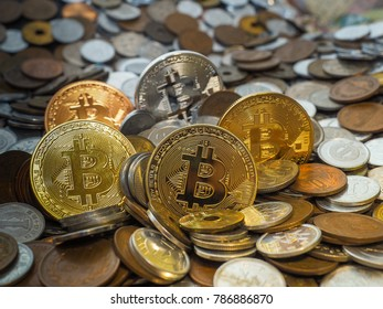Bitcoin crypto currency coins in amoung large stack of coins