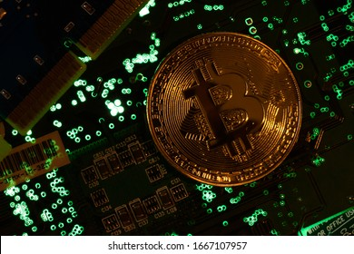 Bitcoin crypto currency comemorative coin on motherbord.