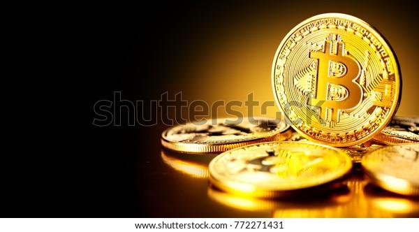 Bitcoin. Crypto currency Gold Bitcoin, BTC, Bit Coin. Macro shot of Bitcoin coins isolated on black background Blockchain technology, bitcoin mining concept.