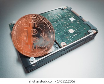 Bitcoin crypto currency place next to harddisk