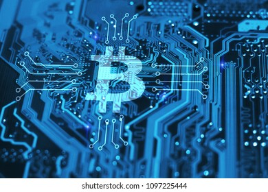 Bitcoin cryptocurency concept on blue integrated circuit on background. Blockchain technology concept.