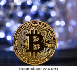 Bitcoin cryptocurrency against blue lights bokeh