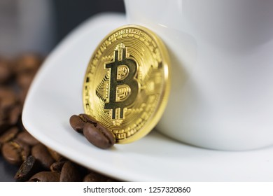 Bitcoin cryptocurrency coin with coffee cup and beans