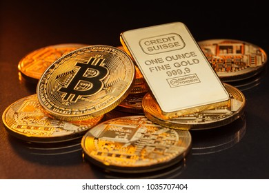 Bitcoin cryptocurrency coin with a gold swiss bank bar