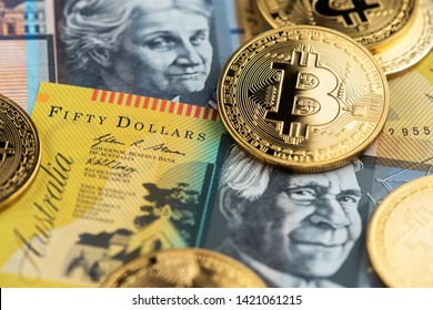 Bitcoin Cryptocurrency coins on Australian Dollar banknotes. Bitcoin Cryptocurrency concept. Australia BTC Bitcoin Cryptocurrency