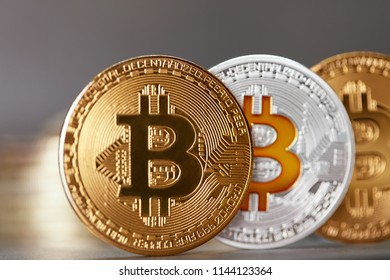 Bitcoin Cryptocurrency Coins. Virtual Money On Table Close Up
