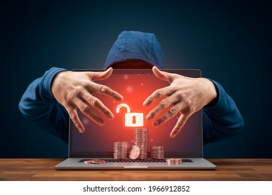 Bitcoin and cryptocurrency cybersecurity concept with hacker behind the unsecured laptop. - Shutterstock ID 1966912852