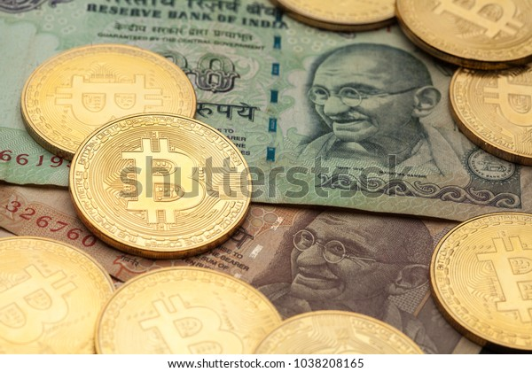 Bitcoin cryptocurrency with Indian rupee banknotes