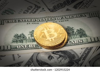 bitcoin cryptocurrency on the background of hundred dollar bills