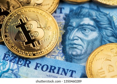Bitcoin Cryptocurrency on Hungarian Forint banknotes close up image. Cryptocurrency Bitcoin with Hungarian Forint money. Hungary Bitcoin Forint Cryptocurrency Blockchain BTC