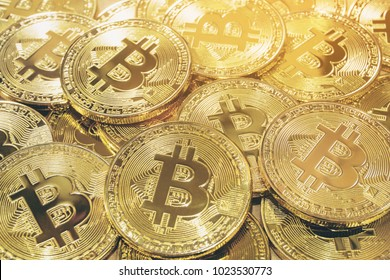 Bitcoin Cryptocurrency pile background - Bitcoin is a new currency that was created in 2009 by an unknown person. It can be used to buy merchandise anonymously.