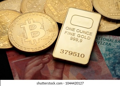 Bitcoin cryptocurrency with swiss franc bills and golden bar