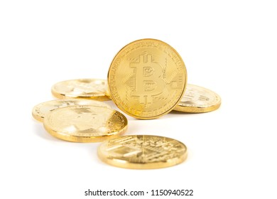 Bitcoin cryptocurrency token pile on white background