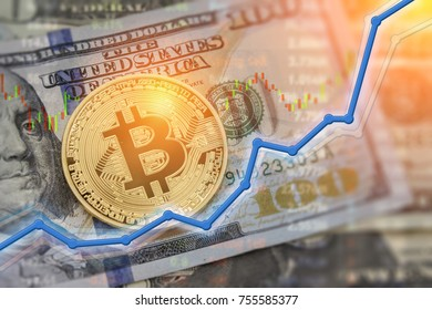 Bitcoin currency and dollar.  BTC market symbol cryptocurrency rising above the united states dollar.  Gold metal bitcoin on top of paper currency.  Copy space for text and wording.