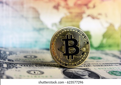 Bitcoin currency on a world map  background on  dollar bill