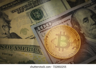 Bitcoin curreny on united states hundred dollar bill with concept of earning money on bank spending.