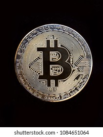 Bitcoin Digital cryptocurrency. Golden coin with bitcoin symbol  over black background