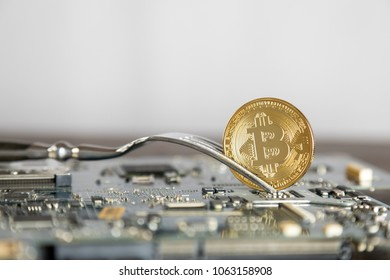 Bitcoin Digital Cryptocurrency Hard Fork Change Concept. Virtual Crypto Currency Coin On Computer Mohterboard.