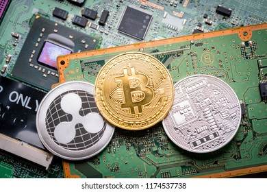 Bitcoin, the digital currency in studio on motherboard background