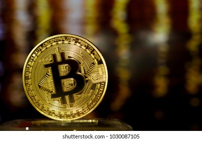 Bitcoin digital currency or Virtual money.Bitcoin is Digital currency modern of Exchange Virtual payment money, Gold Bitcoins circuit on Blur light background. Finance investment concept