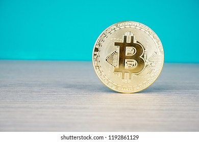 Bitcoin digital decentralised peer to peer on a wooden surface and green background. selective focus