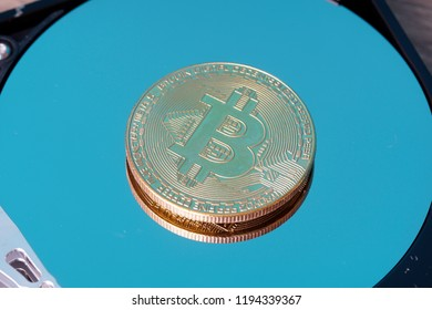 Bitcoin digital decentralised peer to peer on a hard disk surface. Selective focus to the coin