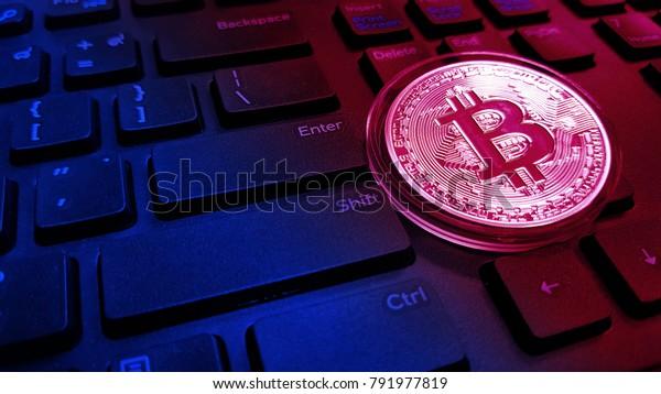Bitcoin, Digital money coin on keyboard. Trading digital money concept