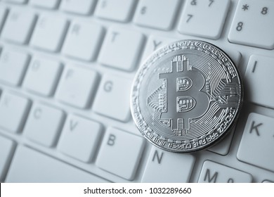 bitcoin digital money on white keyboard and blank space for finance and backing online concept background
