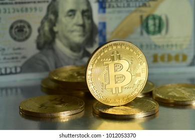 Bitcoin with Dollar Banknote background.