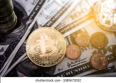 Bitcoin and dollar coins rotating on bills of 100 dollars
