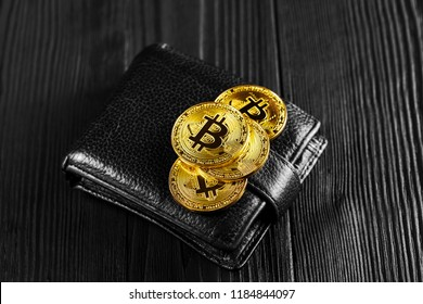 Bitcoin with dollar on purse isolated black background