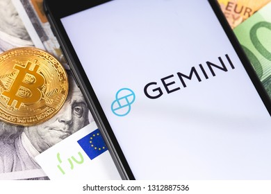 bitcoin, dollars, euro banknotes and Gemini logo of crypto-exchange on the screen smartphone. Gemini is popular largest cryptocurrency exchange on the market. Moscow, Russia - February 13, 2019