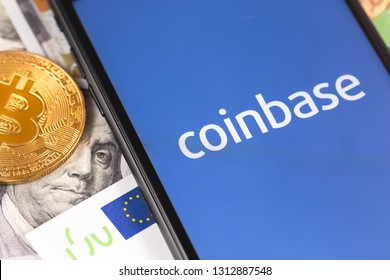 bitcoin, dollars, euro banknotes and smartphone with Coinbase logo on the screen. Coinbase is a digital currency exchange. Moscow, Russia - February 13, 2019