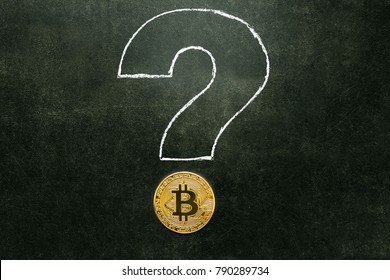 Bitcoin and drawn with chalk on a blackboard question mark.