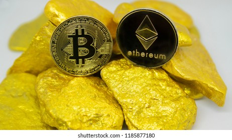 bitcoin and ethereum coin on gold chunks