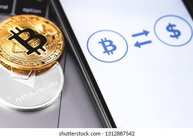 bitcoin and ethereum, exchanger currency on the screen smartphone.