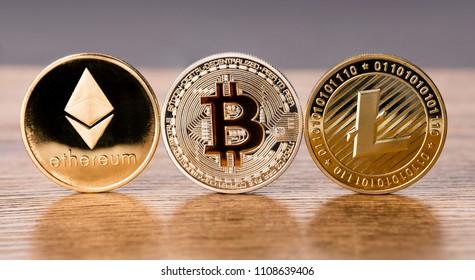 Bitcoin Ethereum Litecoin in a Row on dark background