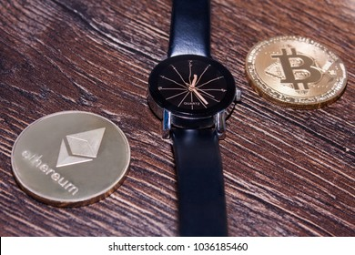 Bitcoin and ethereum on a dark wooden surface