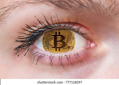 Bitcoin. The eye of a person with the bitcoin logo in the pupil. Coin