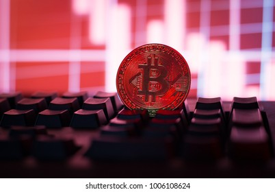 Bitcoin falling down concept.Cryptocurrency physical Bitcoin on computer,pc keyboard