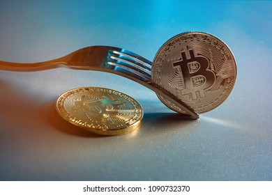 Bitcoin getting New Hard Fork Change, Physical Golden Crytocurrency Coin under the fork, Blockchain Transaction System Crisis Concept