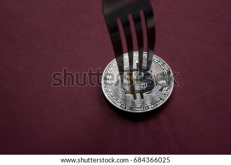 Bitcoin getting New Hard Fork Change, Physical Crytocurrency Coin under the fork, Blockchain Transaction System Crisis Concept