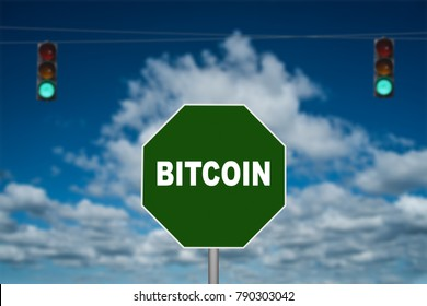Bitcoin go sign with green traffic signal in background