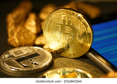 Bitcoin gold coin and defocused chart background.