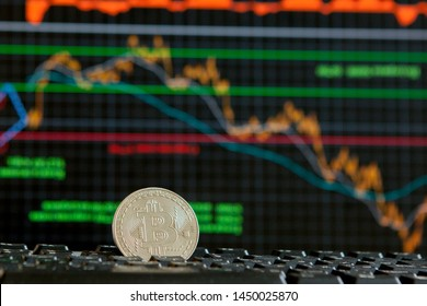 Bitcoin gold coin and defocused chart background. Virtual cryptocurrency concept. Bitcoins on ladder chart cryptocurrency concept. Bitcoin currency with blockchain concept.